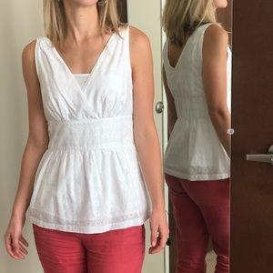White sleeveless blouse with diamond embroidery